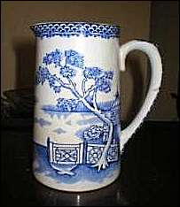 Thomas Till & Sons jug with blue & white decoration.