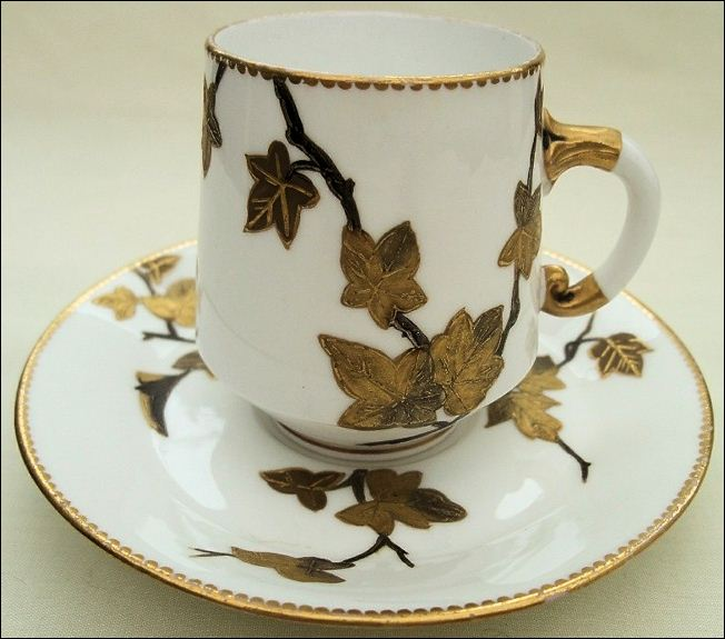 E J D Bodley demitasse cup and saucer with guilded leaves