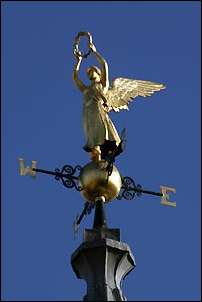 """dominated by the gold angel of the town hall spire"""