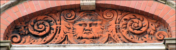 Green Man on the façade of building at corner of Pall Mall