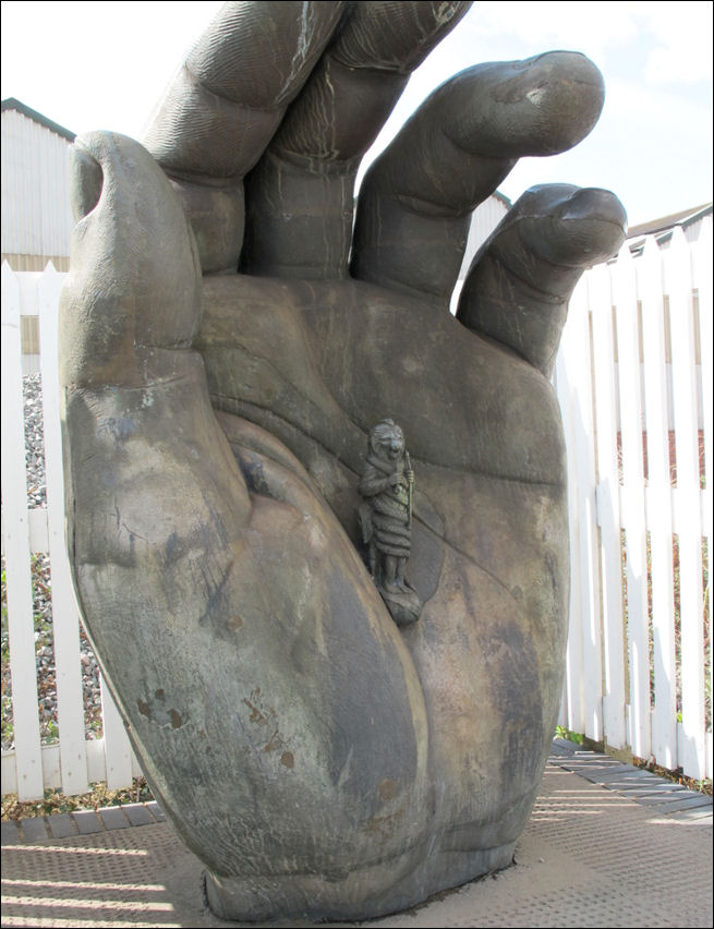 Hand with Chronos, Stoke Railway Station - by Vincent Woropay