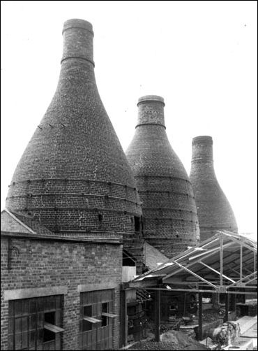 Pottery factory exterior with a view of the bottle ovens at the Dalehall Works