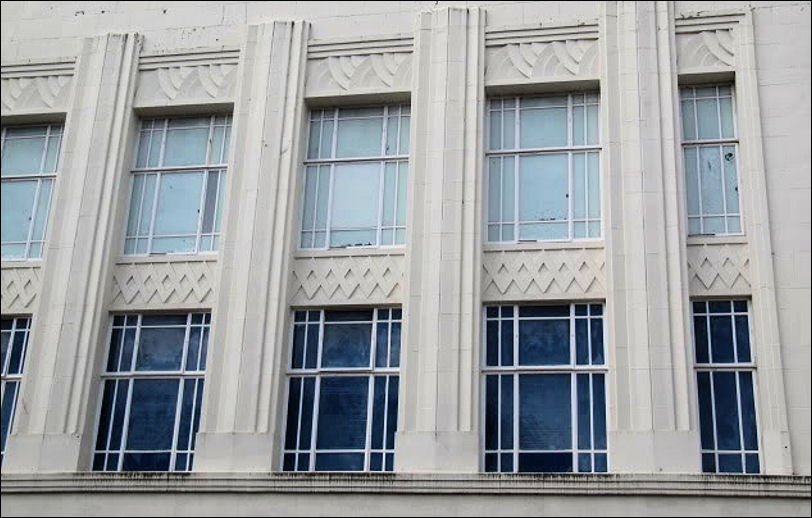 steel frame windows, vertical features and geometric design panels are key art  deco features