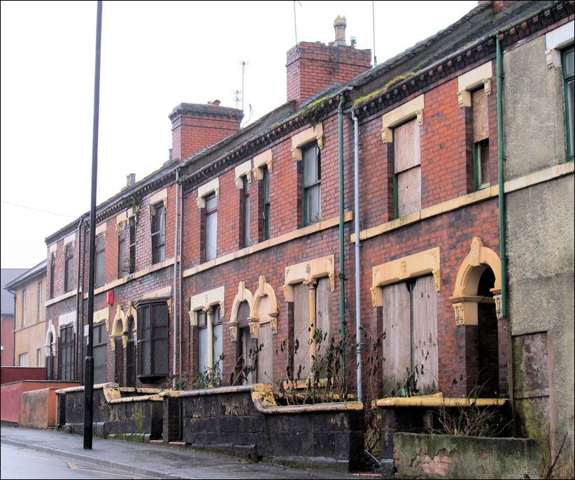the same houses in January 2011 - boarded up and awaiting demolition as part of a clearance programme
