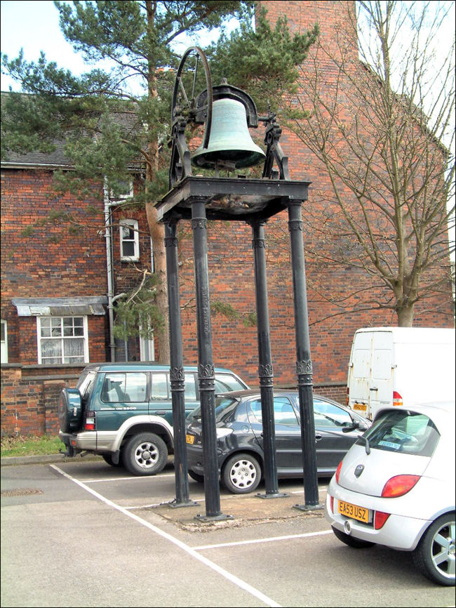 The bell in the car park at the rear of the Holy Trinity Church, Newcastle-under-Lyme