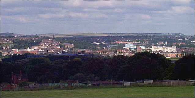 In the foreground the trees of Fenton Cemetery, in the mid view to towards the left can be seen the spire of Penkhull Church.