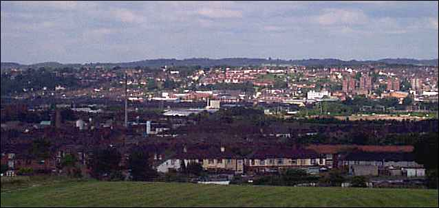 In the distance the Lyme Valley around Newcastle-under-Lyme, in the centre is Stoke and to the centre right are flats near Honeywall