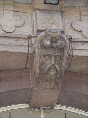 Over the main entrance is a keystone head depicting a mustached man.
